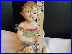 Antique German Bisque Porcelain Piano Baby Girl & Holding a Doll huge