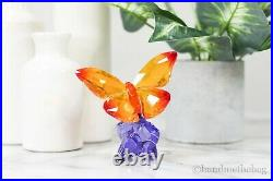 Swarovski (5374943) Butterfly On Flower Purple and Orange Crystal Figurine