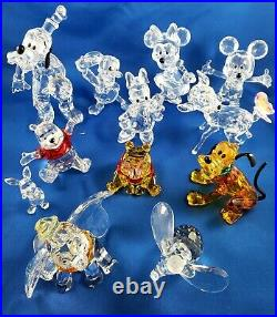 Swarovski crystal disney 12 figurines with original boxes and COA Mint condition